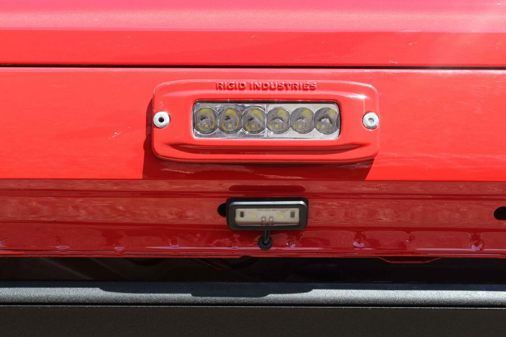 4 Rigid SRQ-2's (top) are frenched into the rocker panels with AMP's step lights below.