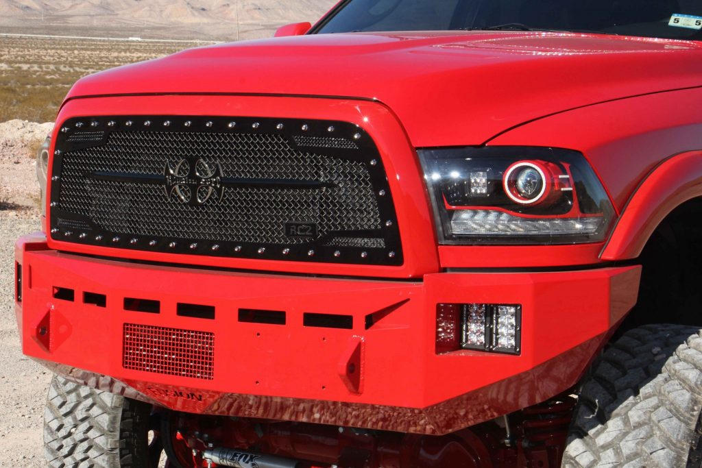 Fusion bumpers, color matched by 5 Kings, protect the front and rear of the truck. Up front a Royalty Core RC1 grille replaced the stock plastic unit.