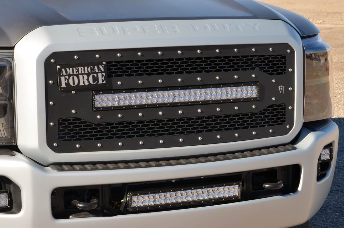 It's all Rigid up front, starting with their 40566 grille insert and a pair of E Series LED light bars, also from Rigid.