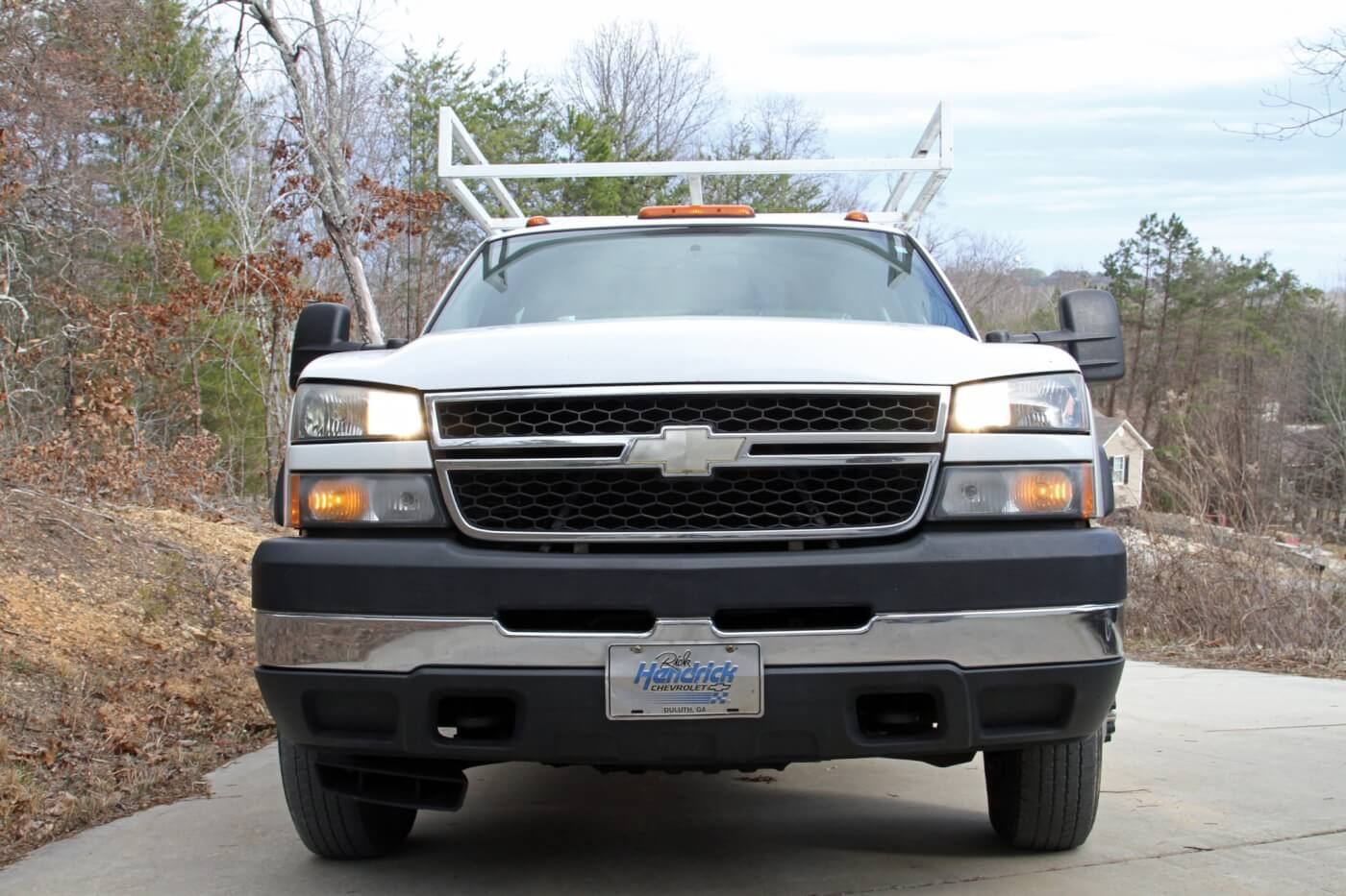 1/2. From the factory GM uses separate bulbs for low beam (photo 01) and high beam (photo 02) operation but does not keep all four bulbs on.