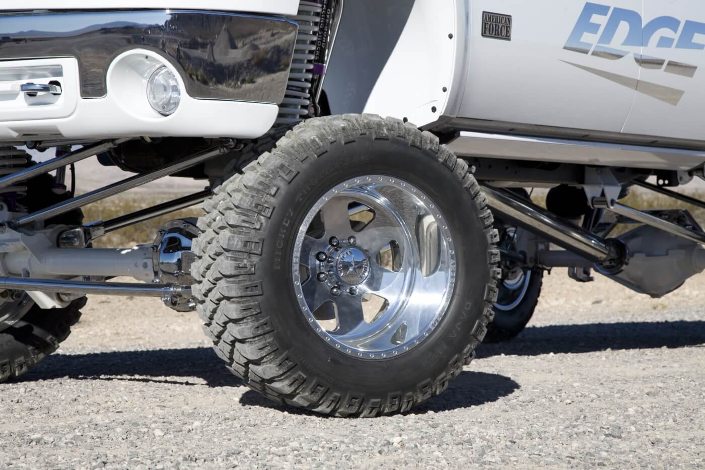 This GMC rolls on a set of Mickey Thompson 36x15.5x20 MZT tires mounted on 22x14 American Force Judge SS8 polished wheels