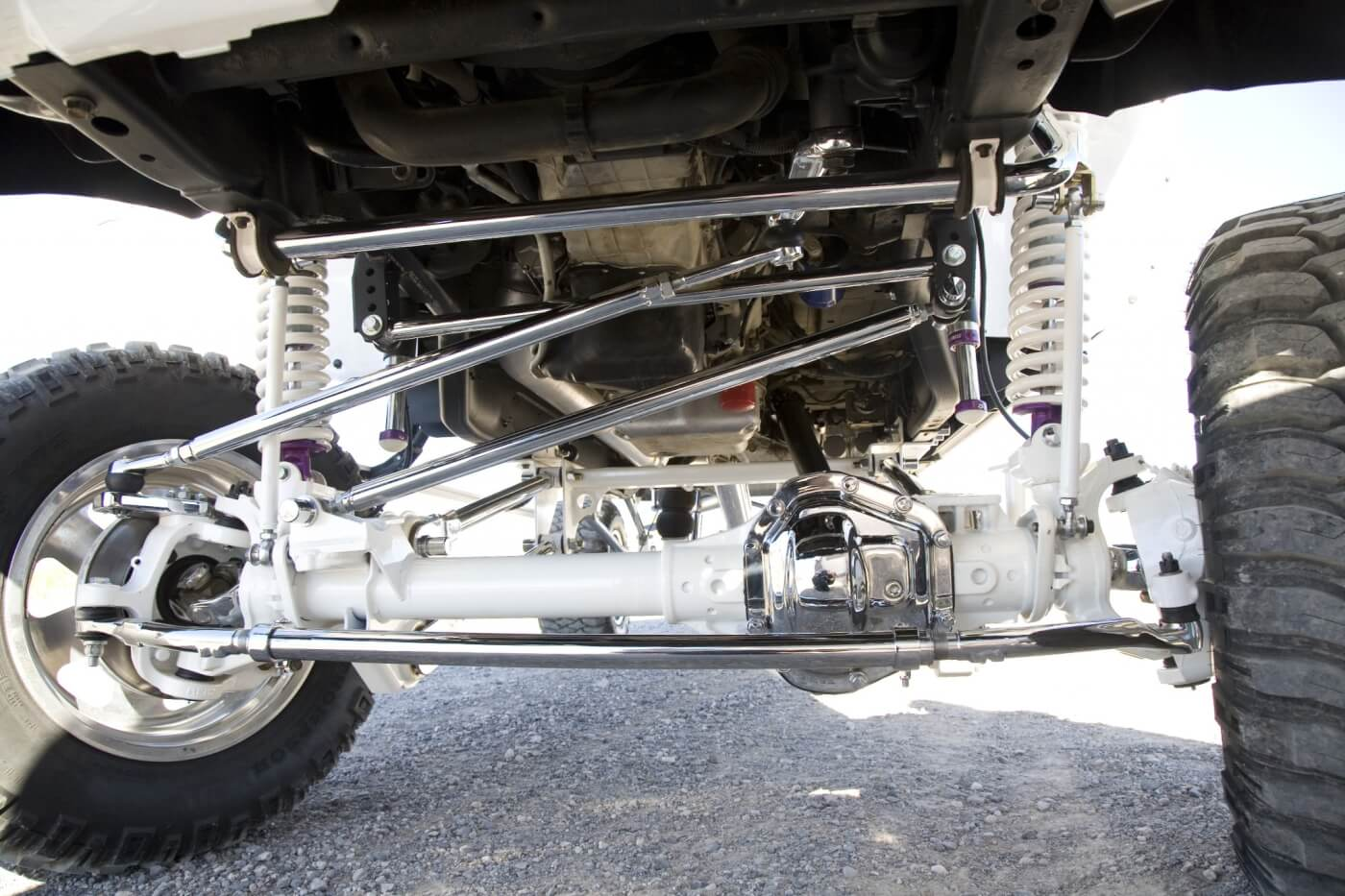 Yep, that's a Dana 60 straight axle under the front end. It's made possible due to the new TCS suspension. The 7-inch TCS Suspension four-link kit is said to be 100-percent bolt-on, with no welding or cutting required. As you can see, the sway bar, tie-rod and steering links were chrome plated. The new front axle and some other components were painted bright white.