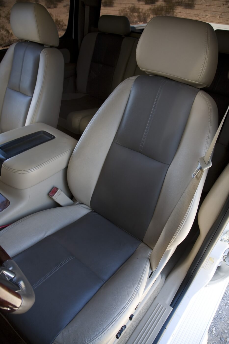 The seats have been recovered, front and rear, with Katzkin leather that matches the factory tan carpet and gray accents.