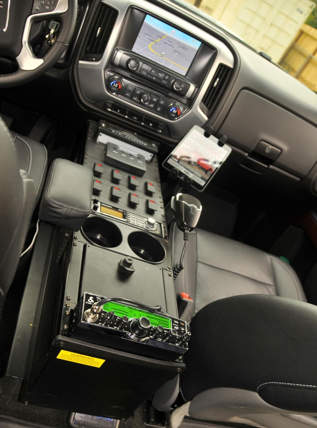 There's a slew of electronics in the 2015 GMC, including a CB radio, police scanner, iPad and more.