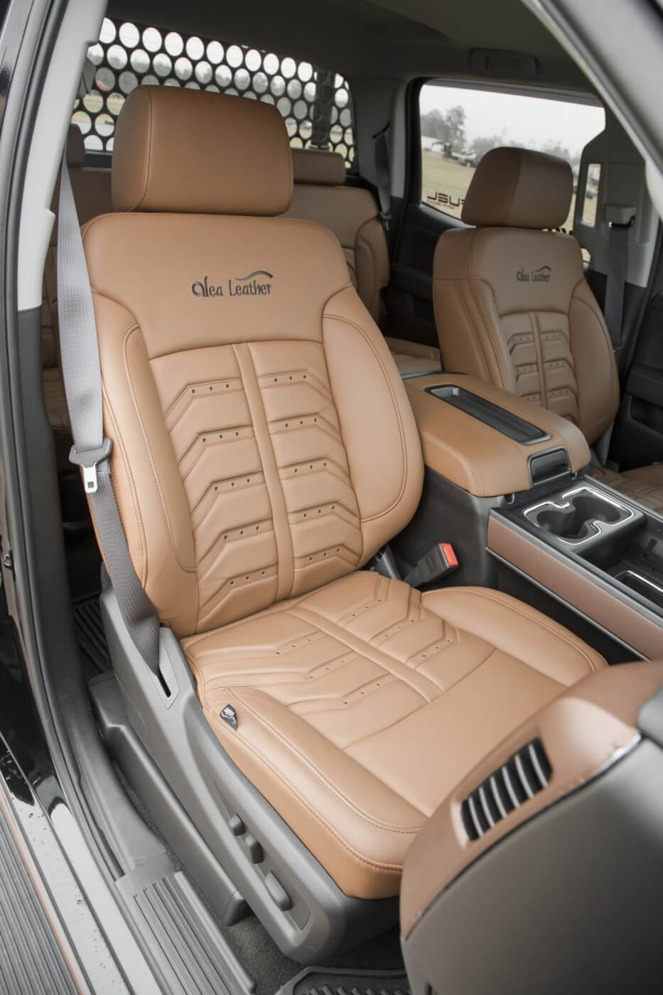 The interior is mostly stock, with the stock seats being recovered with Amaretto-colored Napa grain leather covers from Alea Leather. The sound system was also upgraded with Kicker speakers tied into the factory touchscreen head unit.