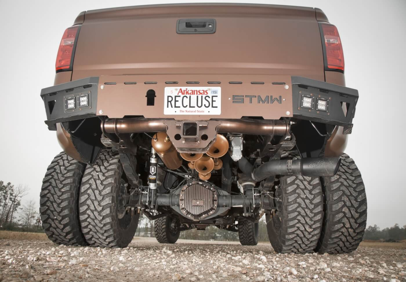 Under the rear of the truck, a set of 5-inch lift leaf springs from Atlas complements the McGaughys front suspension. As with the front, Icon Vehicle Dynamic¬¬ shocks are used. A set of Firestone air bags helps keep the truck level, even with a full load. To feed the air bags and HornBlasters air horns, a Viair compressor system was also installed. The final upgrade under the bumper is the Mag-Hytec differential cover. Regarding the bumper, it's from ShowTime Metal Works. It works with the rear receiver hitch and sports two pairs of OLB LED lights on each corner.