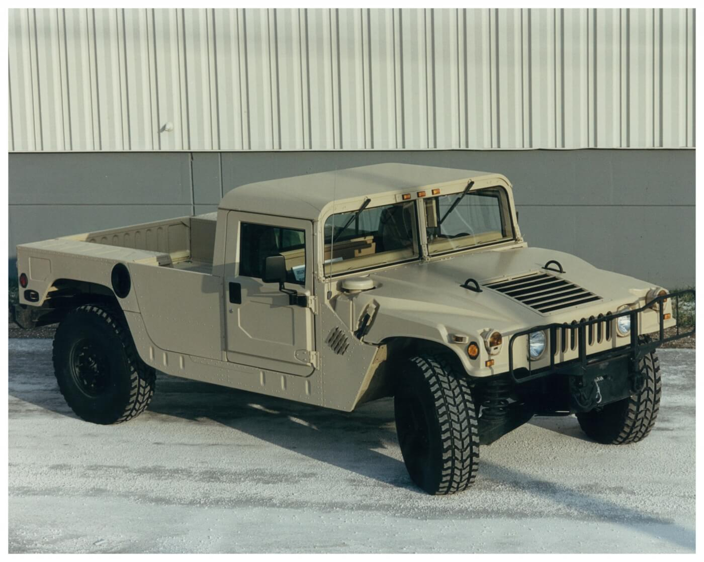 A Hummer H1 in pickup/flatbed two-door configuration. Hummer platforms feature a