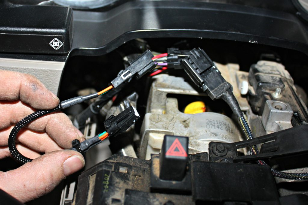 12. As mentioned before, when running the BD VVT Exhaust Brake module in conjunction with the Tapshifter module, their wiring harnesses will be plugged into each other and then piggybacked into the factory wiring harness. While it seems complicated, it really is quite simply to assemble and will work flawlessly if done correctly.