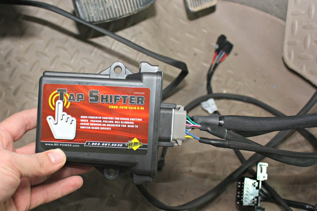 2. BD Diesel engineers developed the first aftermarket Tapshift module for the 2008-2010 6.4L Power Stroke. The system offers five preset shift schedules to improve daily driving and towing needs along with full manual shift control when the need arises.
