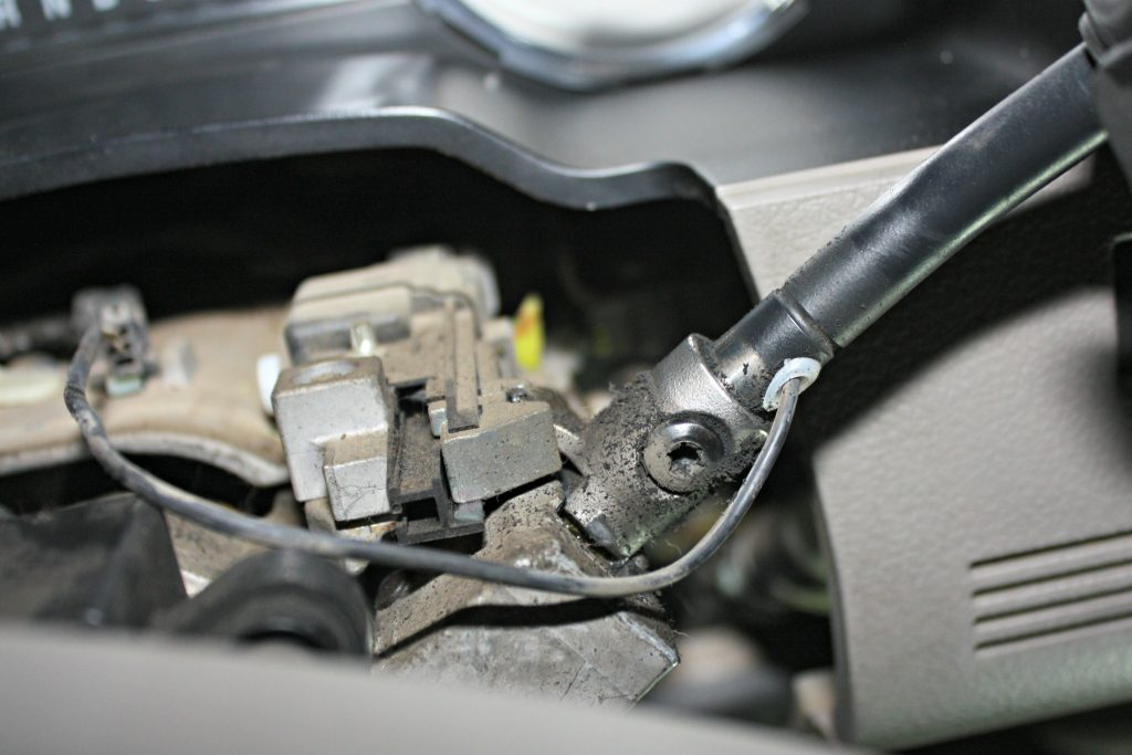 6. With the column cover removed, there's just one wire connector and a T30 torx bolt holding the factory shift lever in place. Since the new shift lever is genuine Ford, it will go back in place of the stocker using the same wire connector and bolt. (If installing the BD VVT Exhaust Brake module like we are, the shift lever will piggyback both the factory and Tapshift harnesses.)