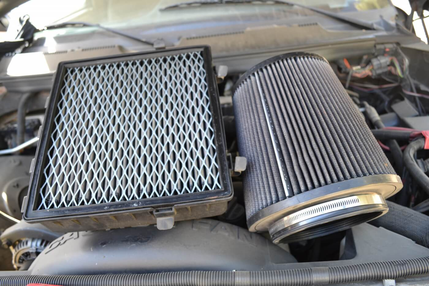 12. If you think of a conical filter spread out and rolled flat, you can see how much more surface area the AFE filter has compared to the filter in the stock airbox.