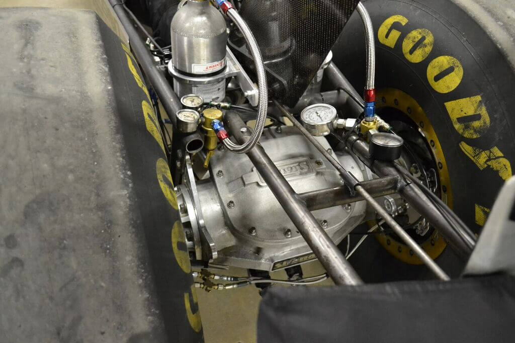 The rear-end of the dragster is standard Top Alcohol fare: a 9.5-inch aluminum top-loader. However, the rear has been fitted with specially made 2.73 gears that Dan bought from a fellow racer, which gives the dragster the needed gearing to go through the traps at 226mph--even with a 1:1 final gear in the Lenco.