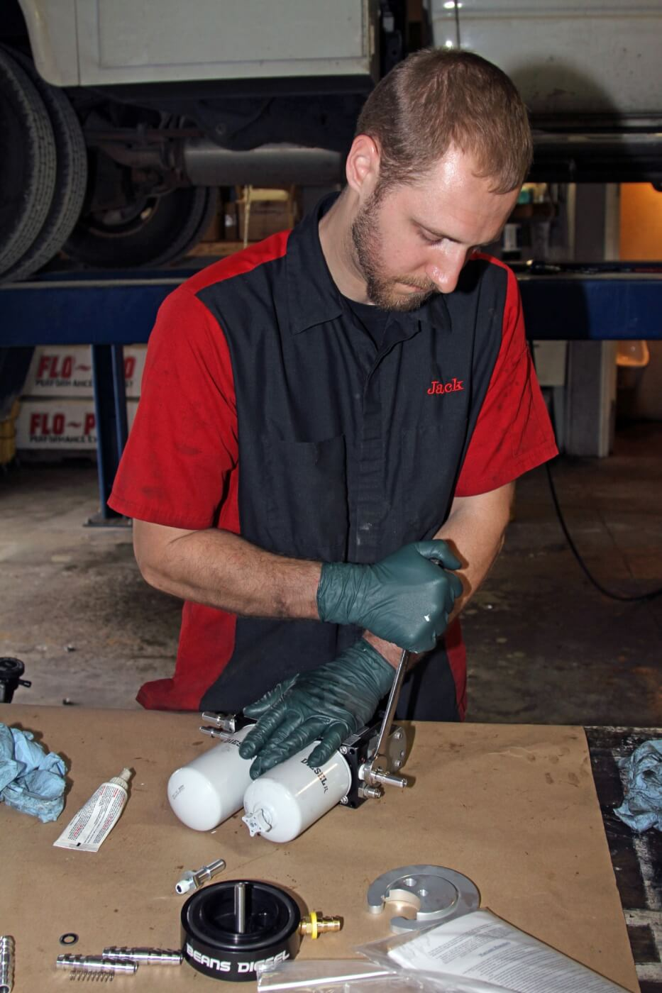 16. After raising the truck, Grubb drilled a small 5/16-inch hole where the BDP sump would be installed to start draining it. While the tank was draining into clean five-gallon buckets, Grubb installed the fittings on the AirDog system and assembled the pump mounting brackets.