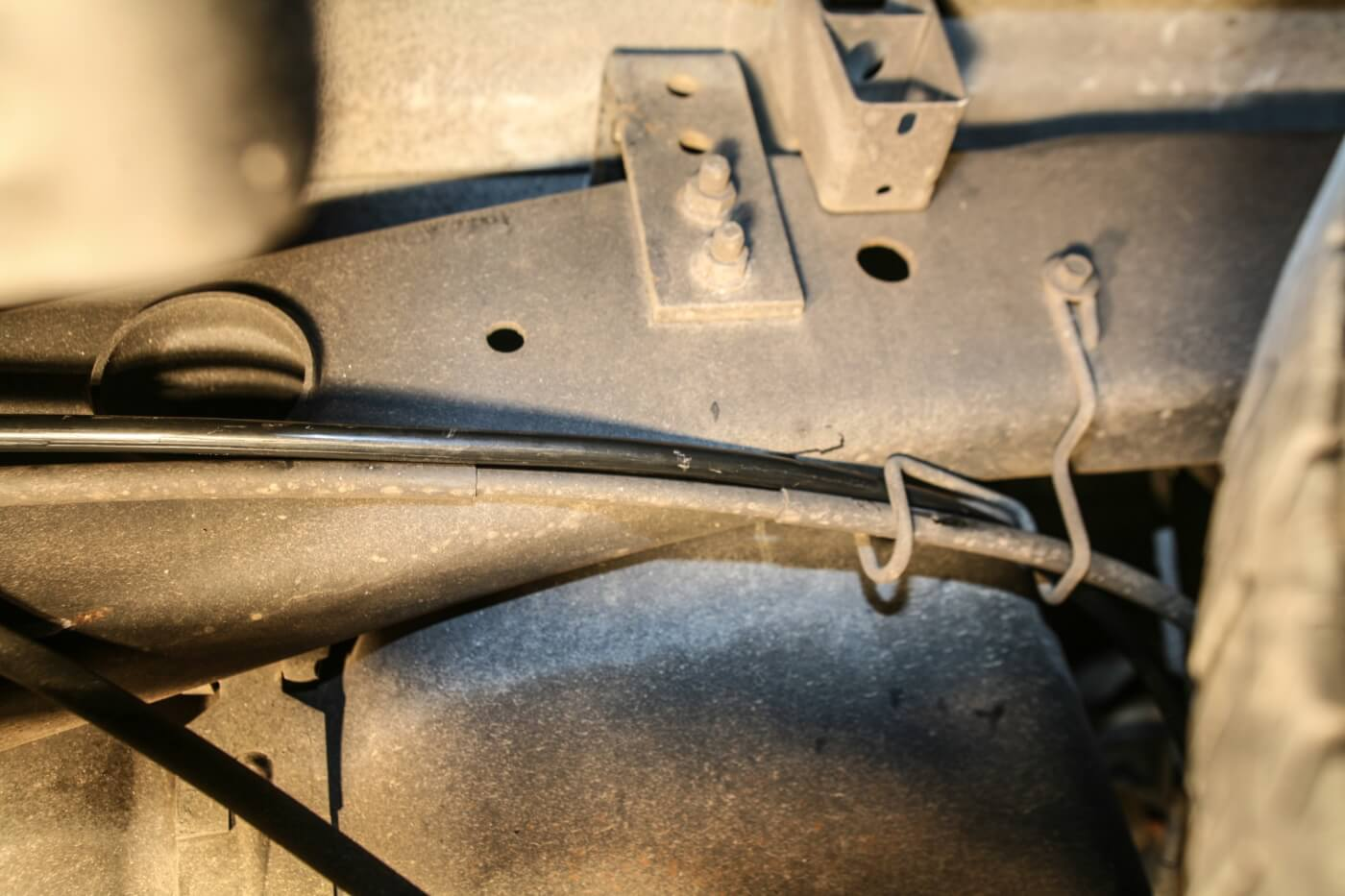 14. We used the factory emergency brake cable hanger and routing locations to plumb the included Kleinn airline from the tank back to the air horns.