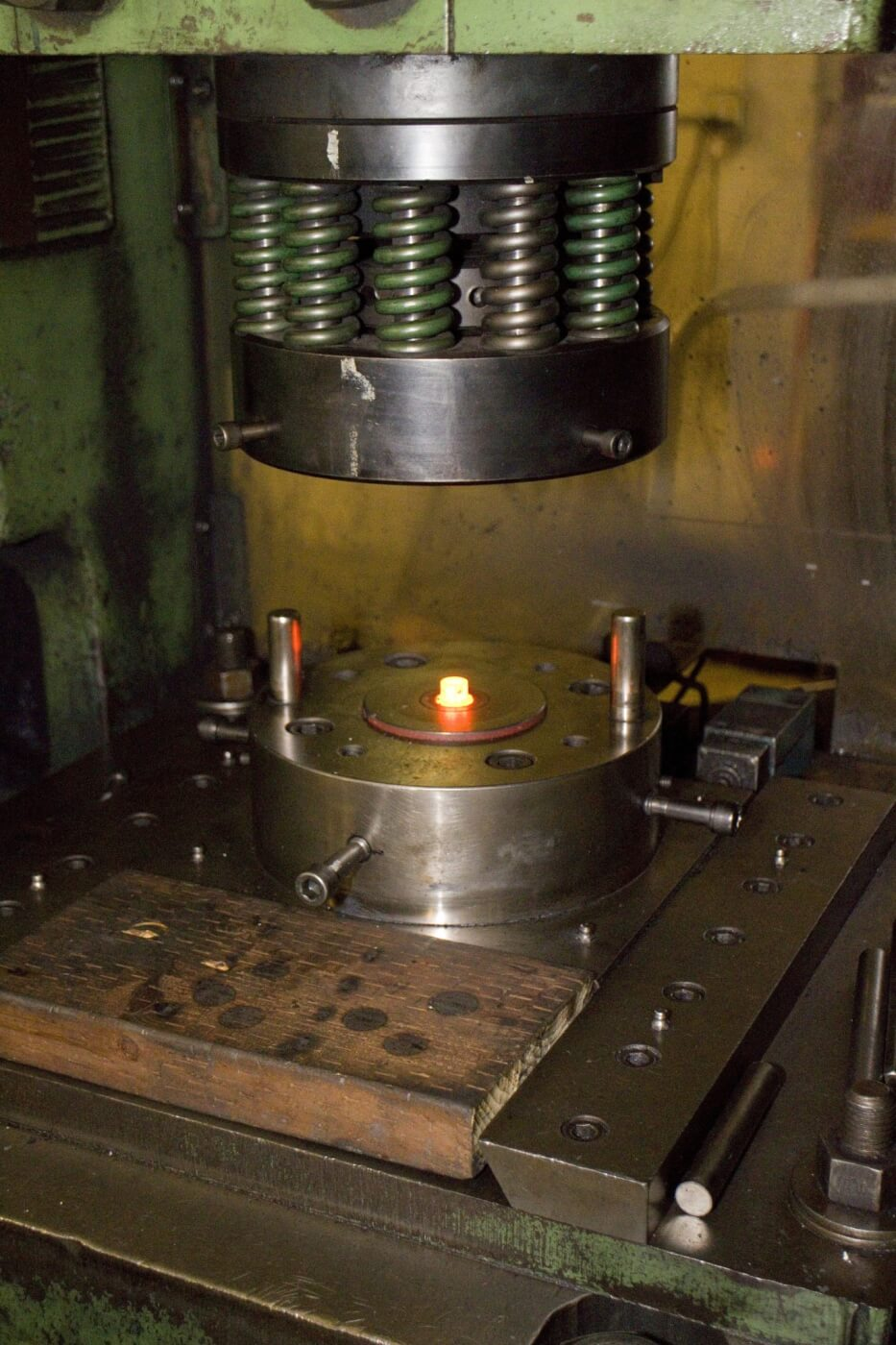 Hot heading involves heating the steel blanks to a precise, red-hot temperature and then putting tons of pressure to form the heads. This process is used for more complicated bolt head designs.