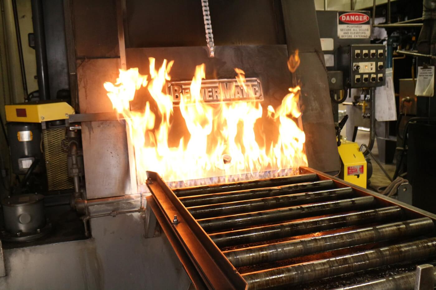 Bolts are sent to the heat-treated ovens to get the correct hardness-- not too soft and not too brittle. This BeaverMatic is a hottie and turns soft steel into hard nuts and bolts.