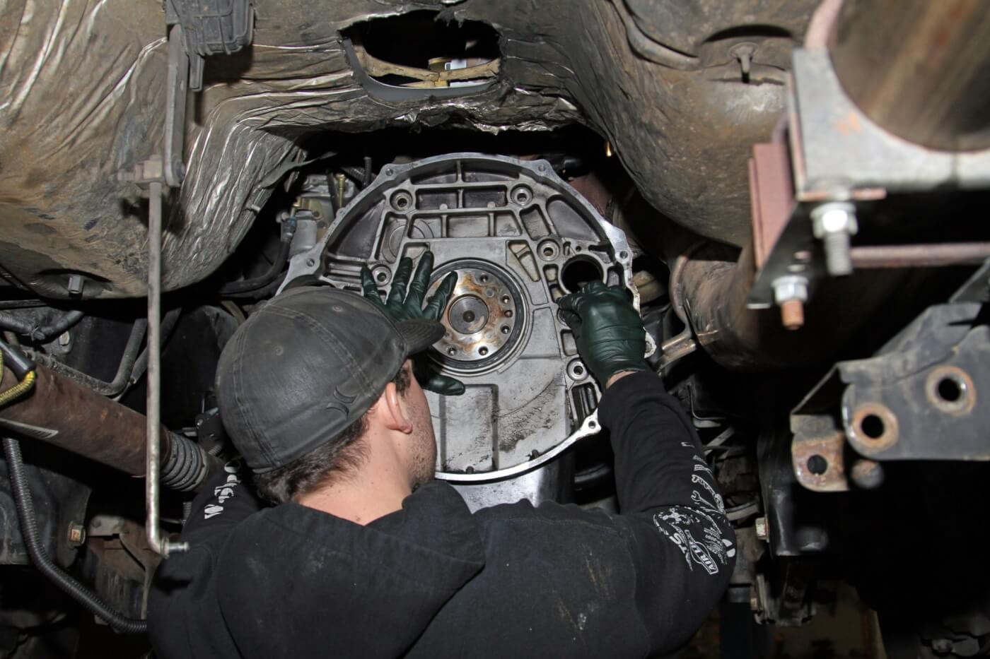 13. After the seal was replaced, Meraz installed a new camshaft seal O-ring in the motor plate and reinstalled it on the engine.