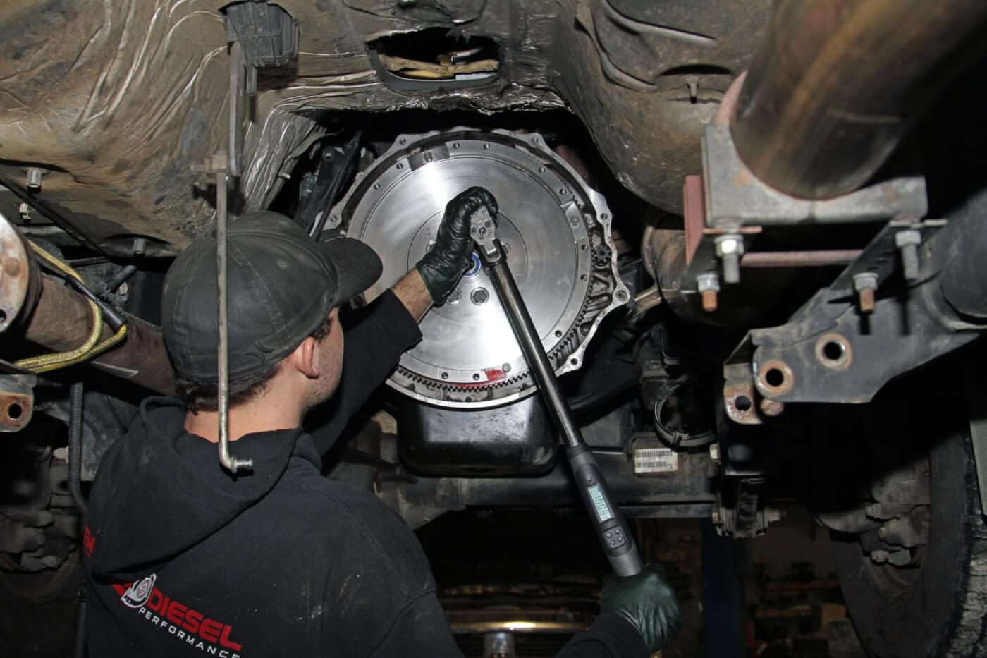 14. Then, he installed the new flywheel using red thread locking compound on the mounting bolts and torqueing them to 100 ft-lbs as directed in the SBC installation manual.