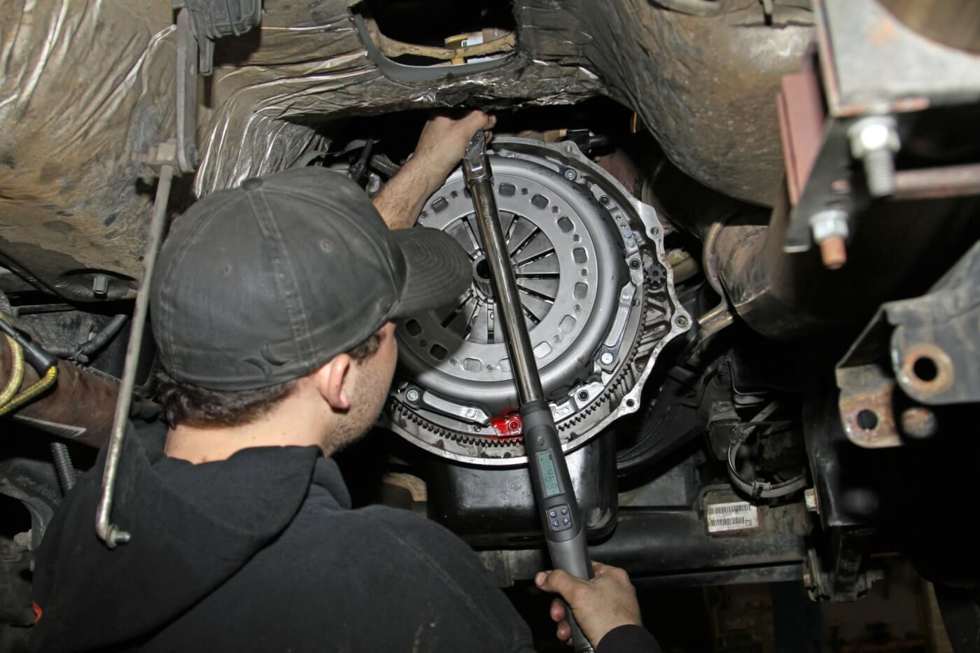15. Next, he used the supplied clutch alignment tool to position the clutch discs and intermediate plate before installing the pressure plate and torqueing those mounting bolts to 45 ft-lbs.