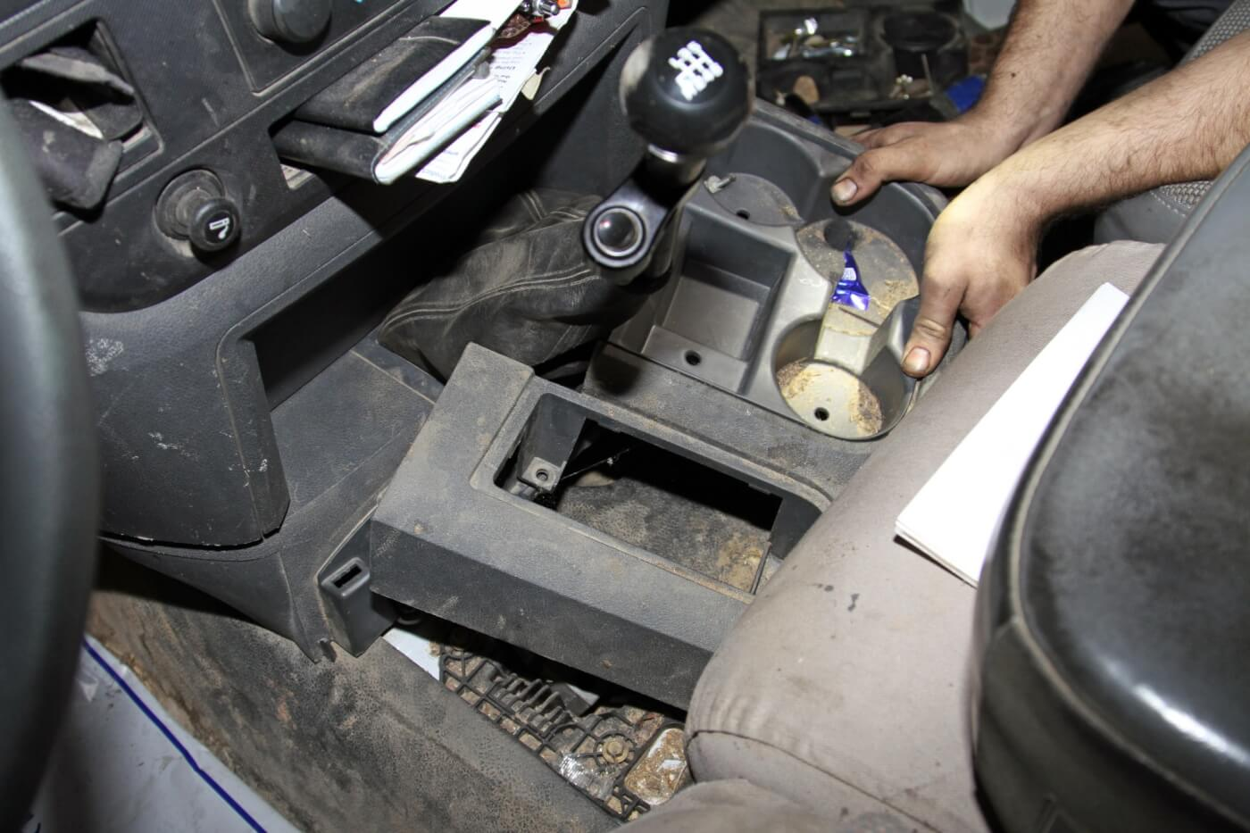 28. Then, he finished up the process by installing the shift levers and console pieces.