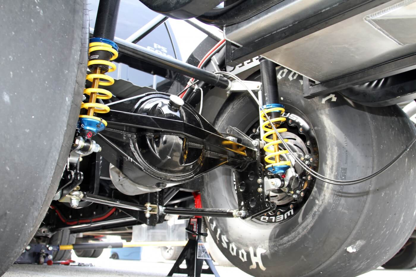 The new frame rails and 4-link suspension were installed to make room for these huge Hoosier drag slicks that are necessary to put the power to the track. Notice the Strange Engineering Pro-Race 9.5 rear axle and Competition Suspension coil over shocks: this truck is built for one purpose—to go fast.