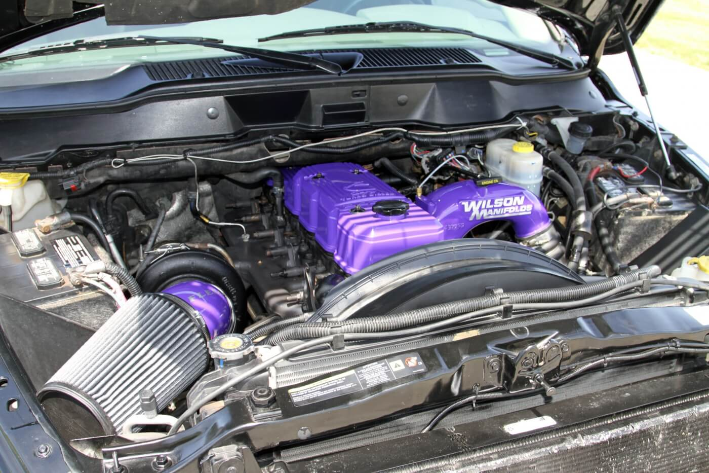 Lifting the hood, you'll find the bright purple paint highlighting the intake manifold, valve cover and turbo intake.