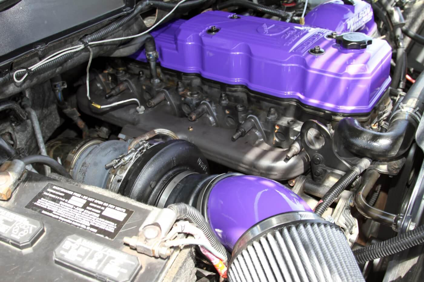 The passenger side of the 5.9L Cummins is dominated by a Steed Speed manifold and a Fleece Performance Engineering S468 turbocharger.