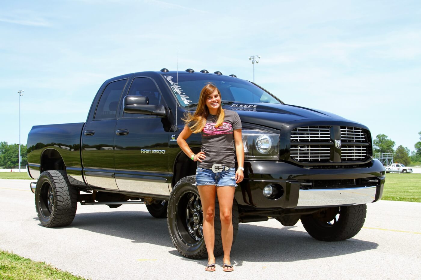 Trisha Finke stands proud with her 800-HP daily-driver Dodge Ram!