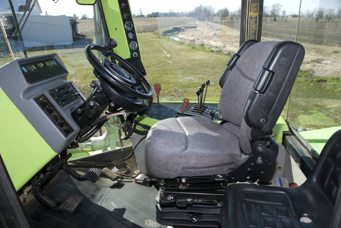 A nice place to work. Plenty of visibility, air conditioning, a suspended seat with armrests, a nice sound system and plenty of controls to keep you occupied. It even has autosteer tied in with a GPS and automation for planter and fertilizer application. The hour meter shows 1380 hours.