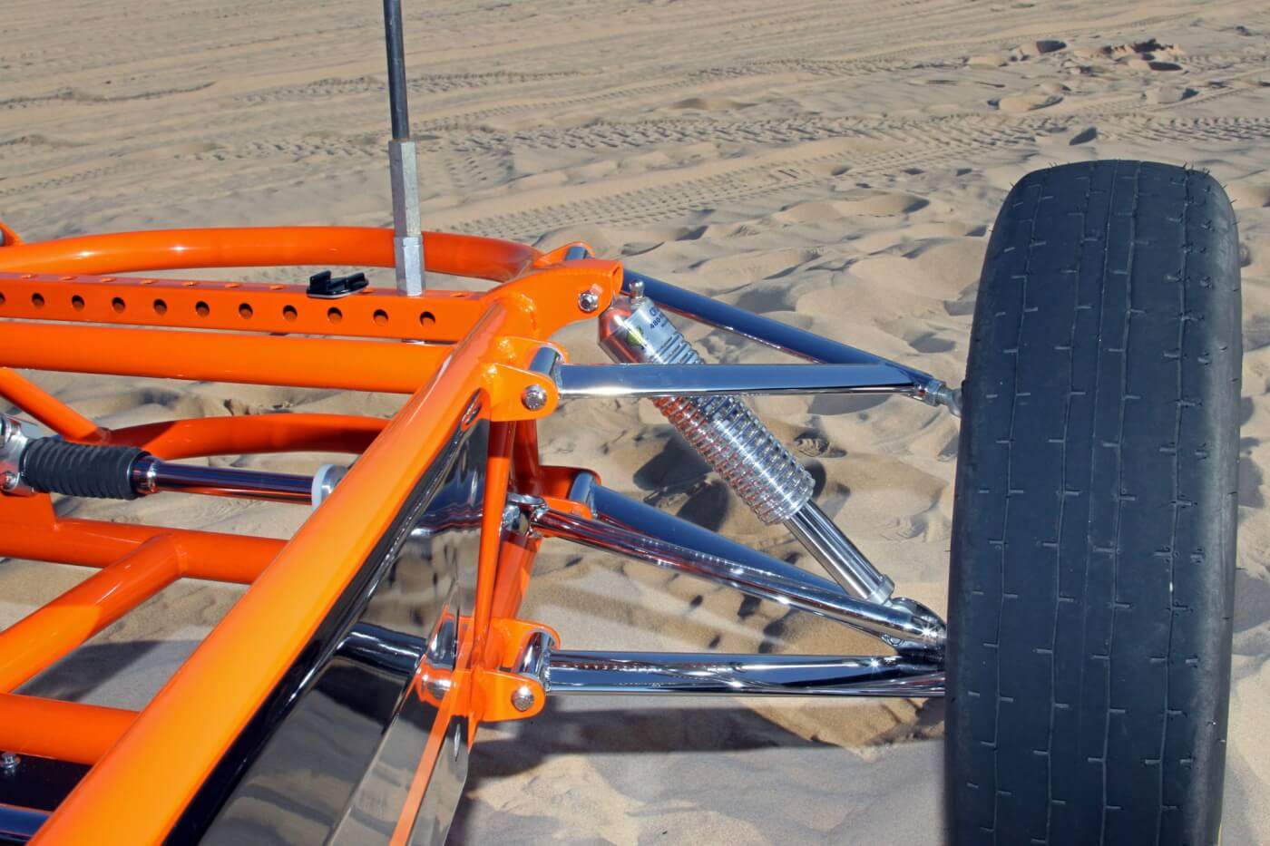 The front suspension features low profile A-arms along with polished MS Cruisers shocks to tame the bumps in the sand.