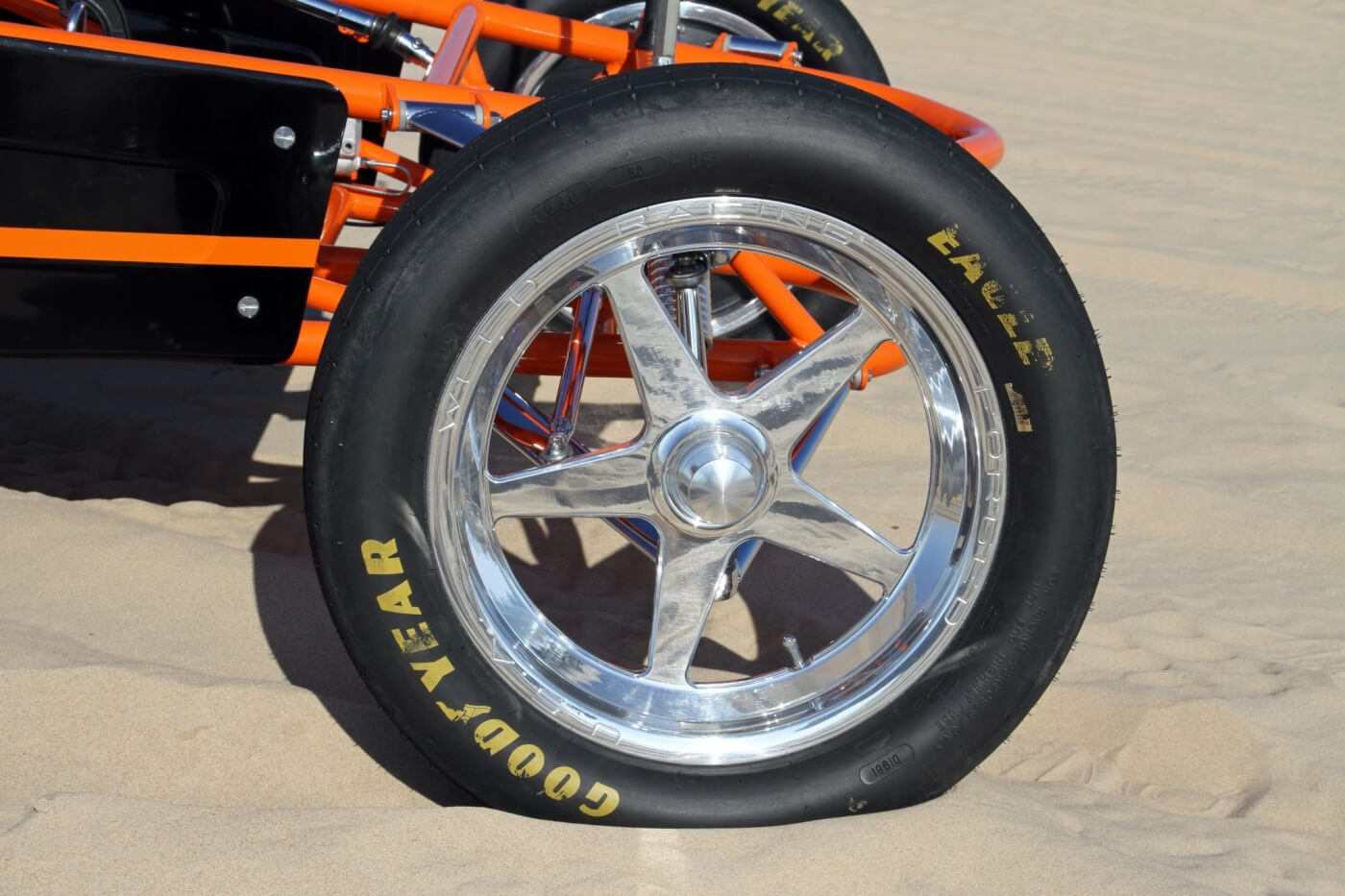 The front tires are a set of Goodyear Eagle drag tires to handle race speeds without an issue; they're wrapped around a set of polished spindle-mount Weld Racing wheels.