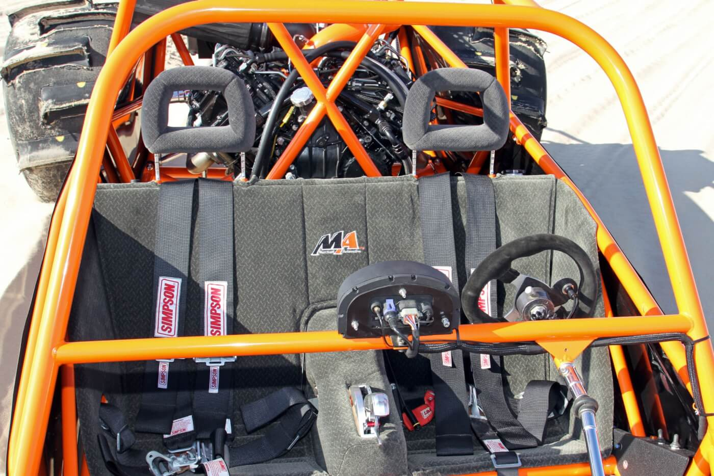 The cockpit's sparse and built for racing but comes complete with Simpson 5-point harnesses to hold the driver and passenger securely into the custom formed aluminum seat.