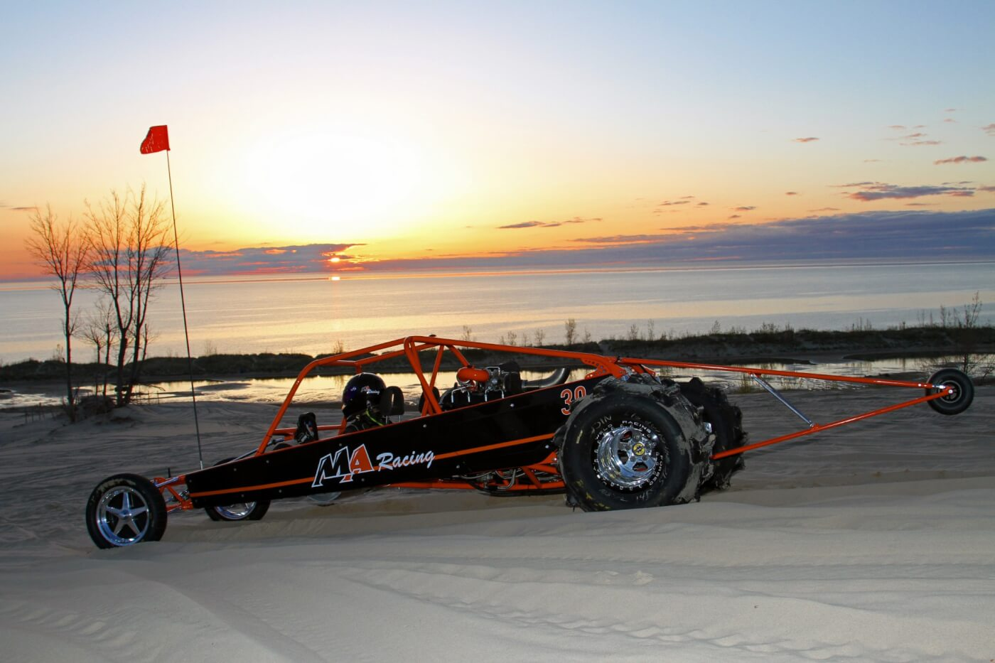 Sunset on Lake Michigan is a beautiful sight, especially if you're a gearhead with a Duramax-powered sand rail to blast across the dunes.