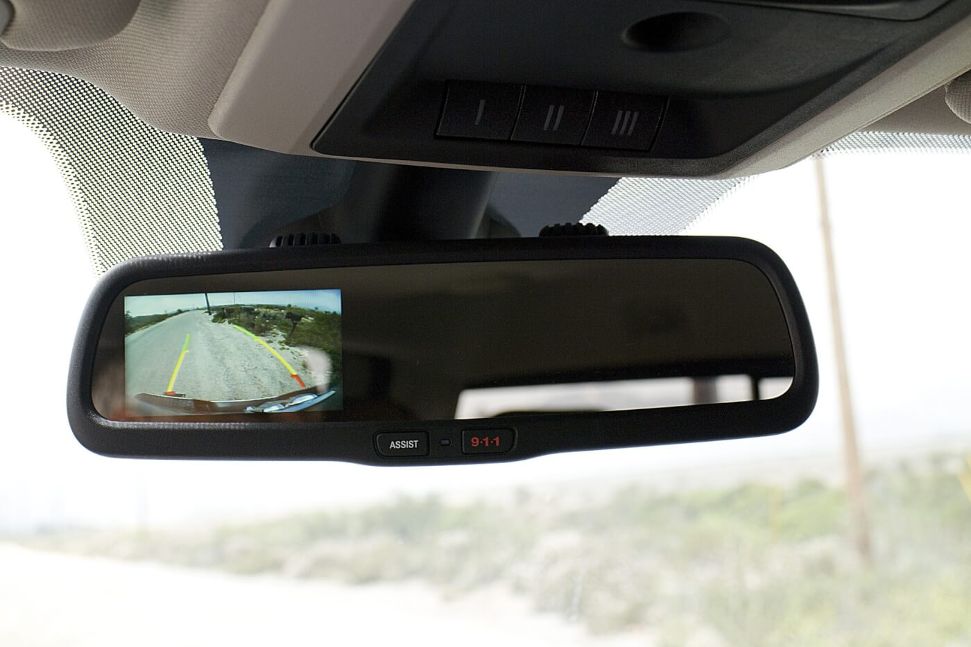 11. Our test truck featured a backup camera that displays in the rear view mirror. While not a large a screen as a dash display, it ensures that you are looking at the backup camera and the mirror at the same time. This makes backing up a little safer, but don't forget to use your side mirrors too.