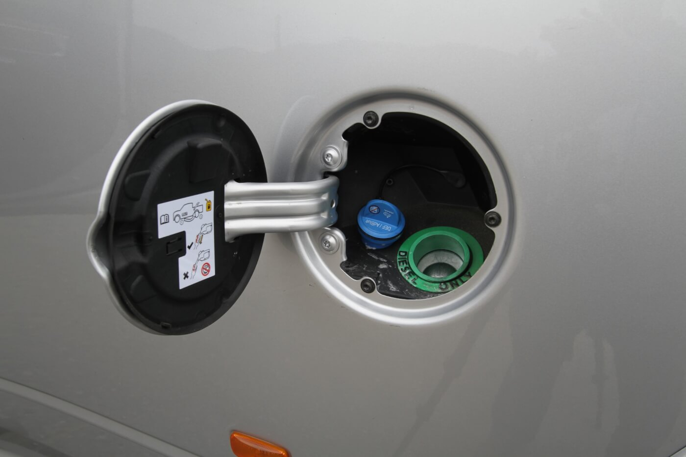 12. All new diesel trucks now require DEF, diesel exhaust fluid. The Ram 3500 places the DEF filler in the fuel door, next to the fuel fill. The DEF filler is the blue one, as is the required standard.