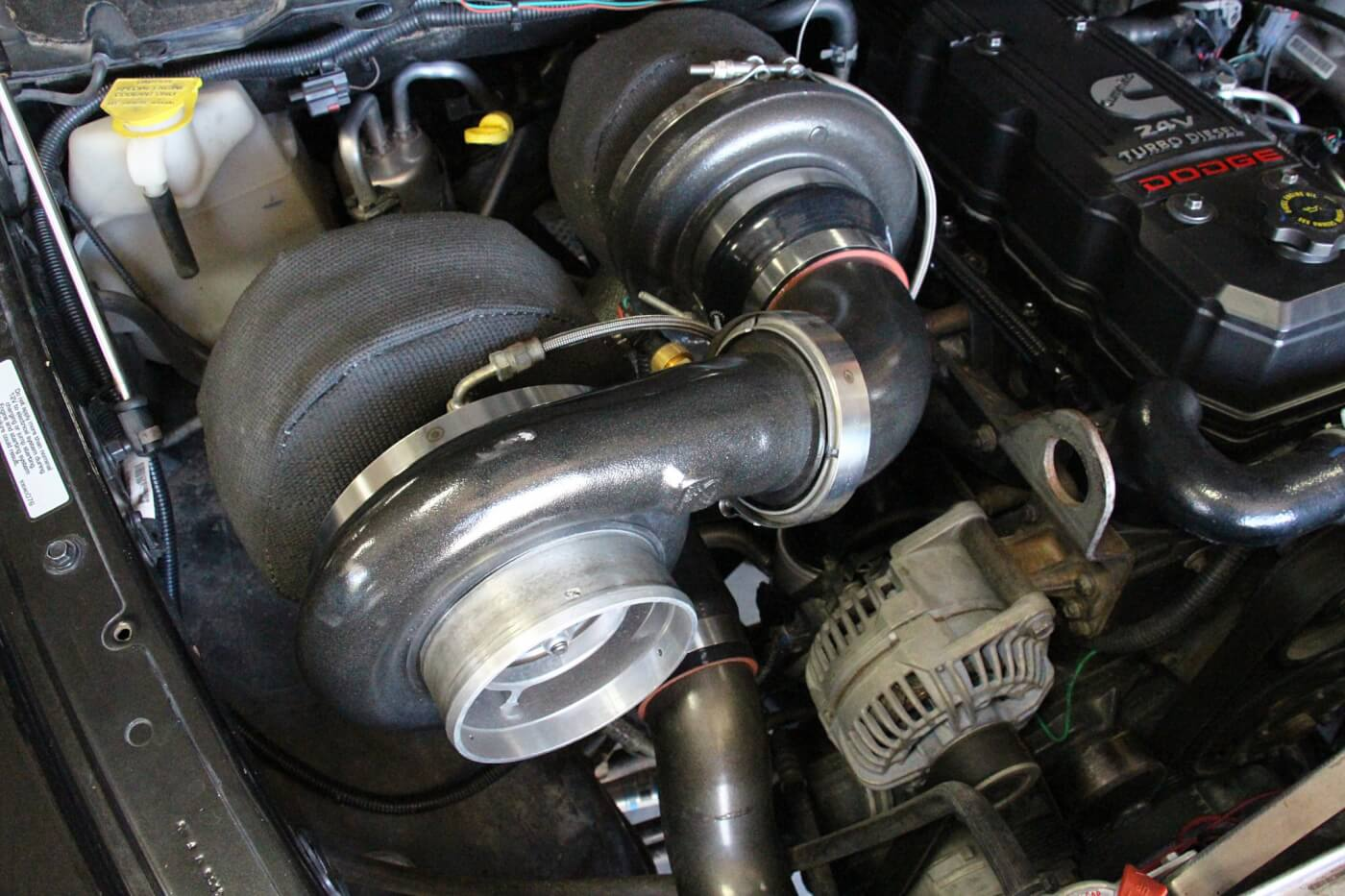 Big power calls for big turbos, so after building the engine, the guys at Midwest Truck Products sized a pair of S400-based BorgWarner chargers and fabricated all of the appropriate plumbing. The atmosphere turbo features a billet 84mm compressor wheel, the common 96mm turbine wheel, and 1.32 A/R exhaust housing and utilizes a T6 flange. The manifold charger is comprised of a 64mm billet compressor wheel, 83mm turbine wheel, .90 A/R exhaust housing, and mounts to an ATS T4 exhaust manifold.