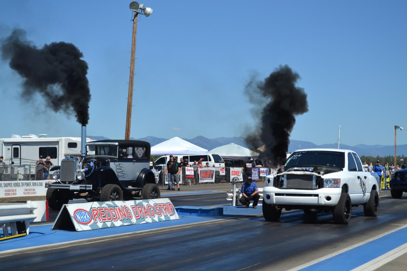 "As the competition went on, we saw a number of interesting pairings, like this diesel street rod (known as ""The Fodge"") that lined up against a common-rail drag truck."
