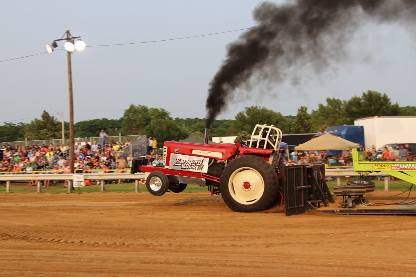 A slew of hot-running tractors showed up for the 9,500-pound 466 class sanctioned by the Heartland Tractor Pullers Association. Here, Tim Vorwald lays down a textbook pass with his Farmall 450. He would finish in Third Place with a distance of 301.9 feet.