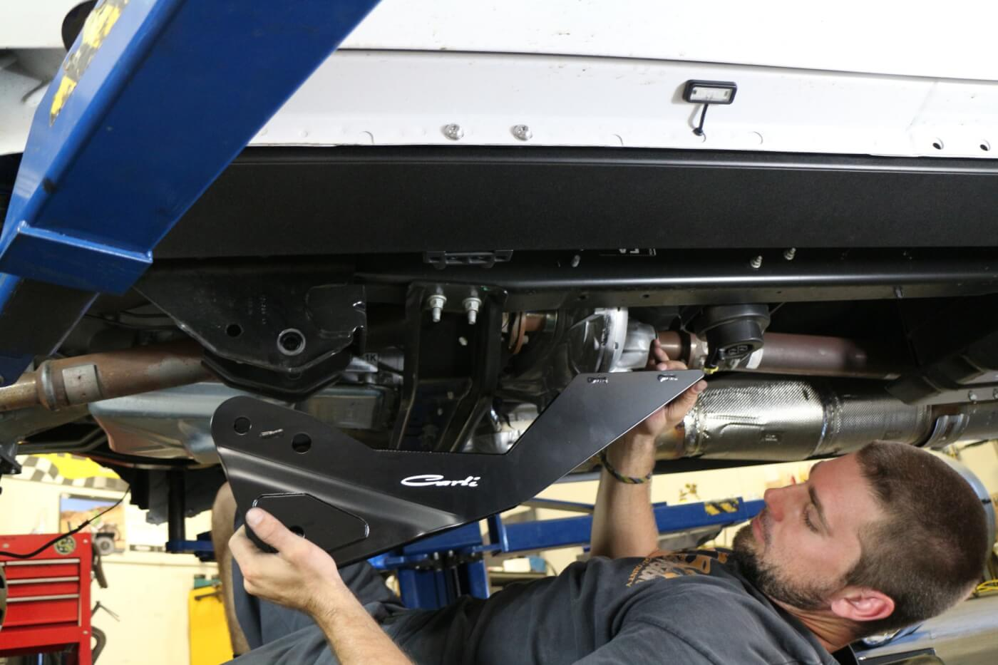 8. Before the new Carli front suspension arms can be installed, the drop down bracket must be installed on the frame.