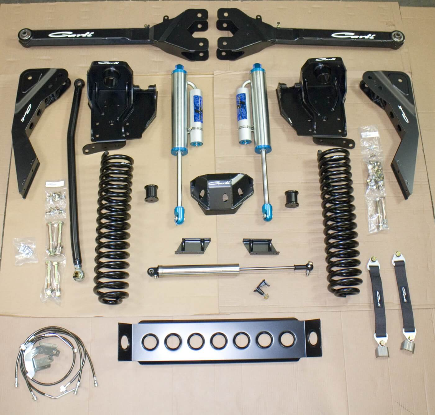 1. Here you see the front components of the Ford F-250 lift in these pages. This is the full Dominator 3.0, 4.5-inch lift setup. The front upgrade included new King remote reservoir shocks, longer springs, new front coils, coil buckets and much more.