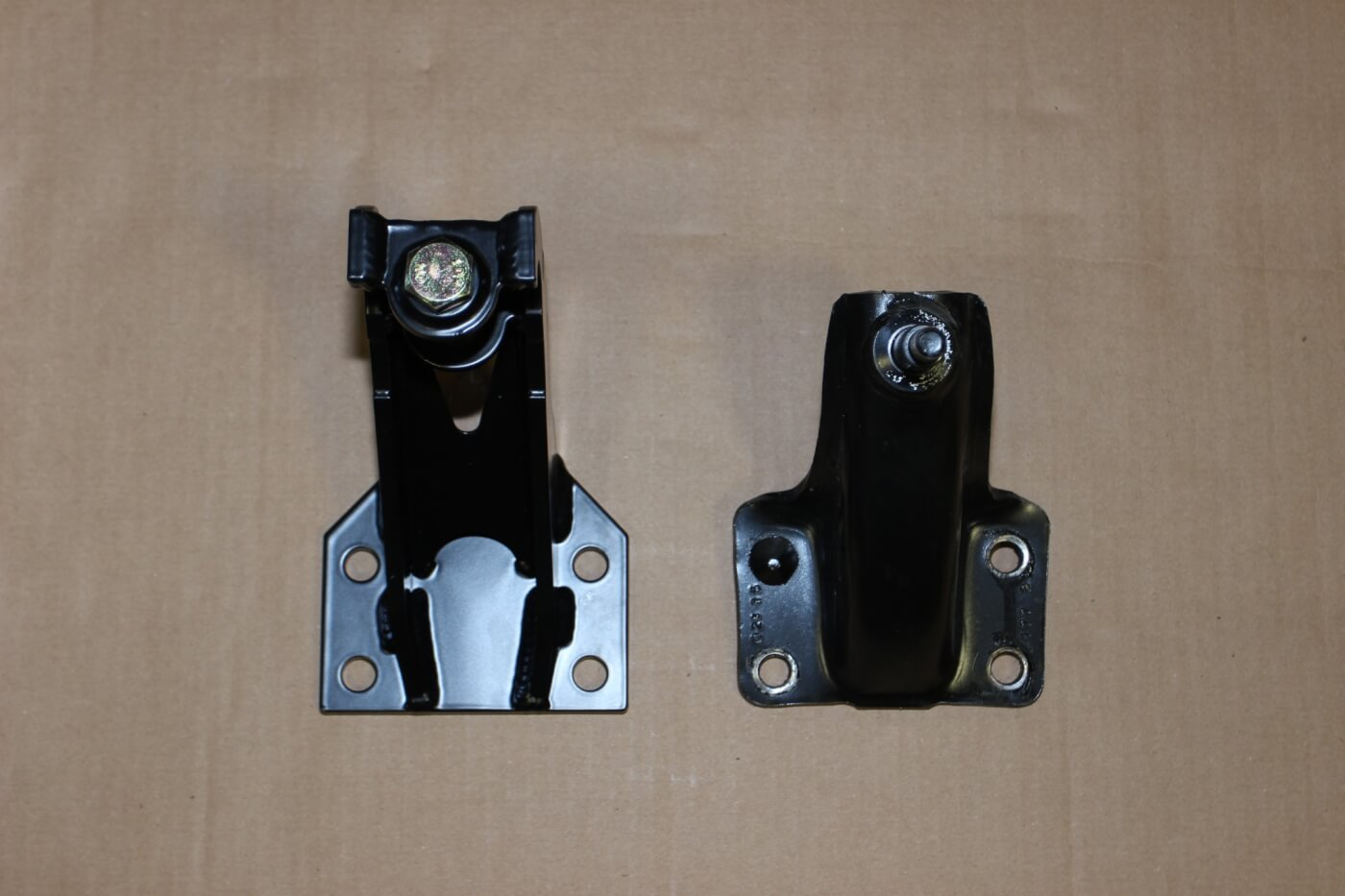 13. Here you see the new Carli rear shock mount (L) compared to the OEM mount. The OEM mount must be cut off the frame since it is riveted.