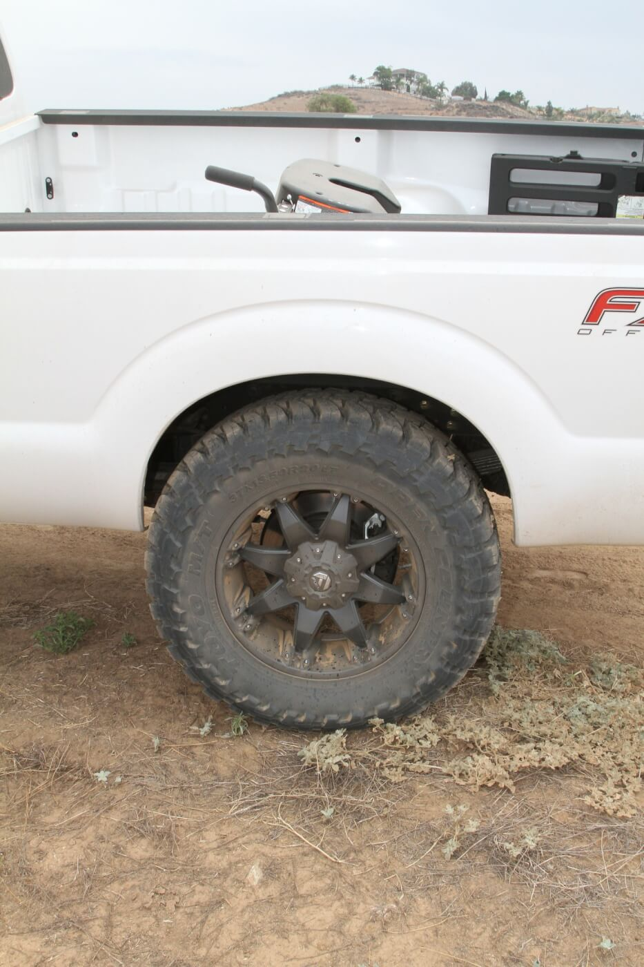 18. This Toyo Open Country AT 37x13.5R20LT fills the rear wheel opening and looks cool mounted on a Fuel 20x9 Octane wheel. Here the suspension on this side is against the rear bump stops. At normal ride height, there's even more clearance around this huge tire.