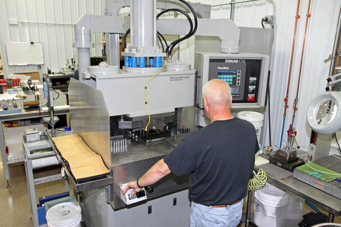 10. Greg Spoolstra operates the AFM machine to show us the process S&S nozzles go through.
