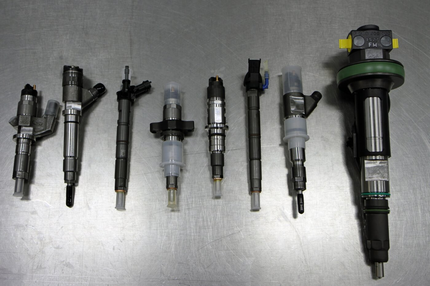 14. Here is a selection of some of the injector options offered by S&S Diesel Motorsport covering everything from stock type injectors up to monster injectors for custom applications. From left to right are injectors for an LB7, LBZ, LML (piezoelectric), 5.9L Cummins, 6.7L Cummins (next gen), 6.7L Scorpion, Case IH and LE (Large Engine with 2.5 to 3.0L per cylinder).