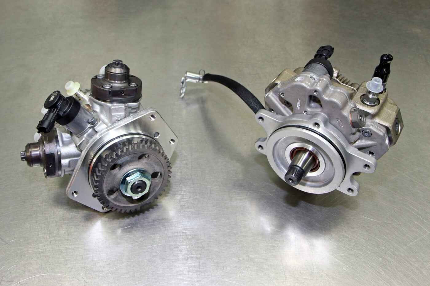 18. A stock CP4 is shown on the left with the S&S replacement CP3 unit shown on the right. The CP4 to CP3 upgrade kit for the Duramax engine will even work with the ninth injector for emissions compliance, while replacing the troublesome CP4 with the more reliable CP3.