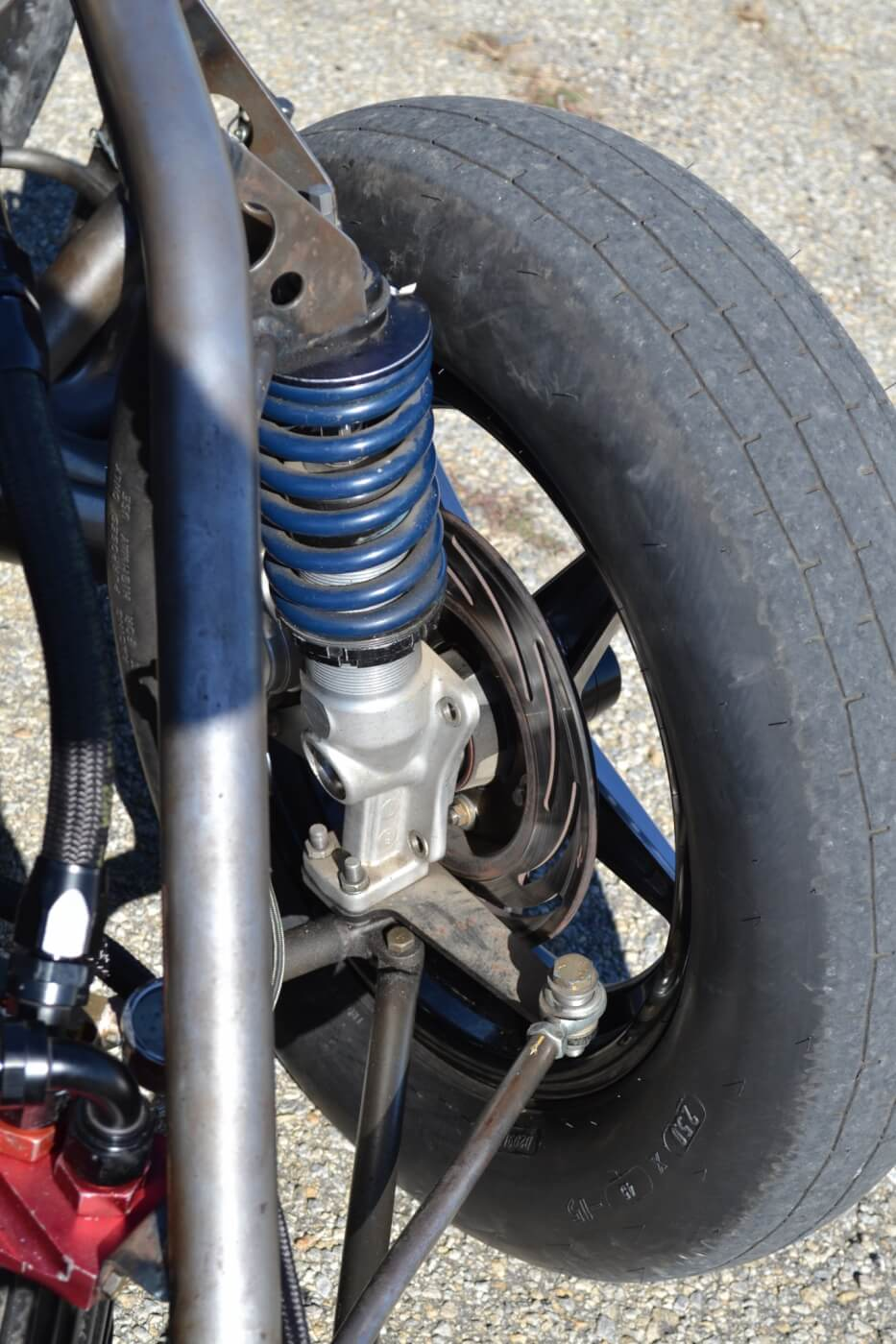 The front suspension is also a drag race affair, as Strange struts are employed. Combined with a rack and pinion steering unit, the entire front steering, suspension, and brakes are well under 100 lbs. combined.