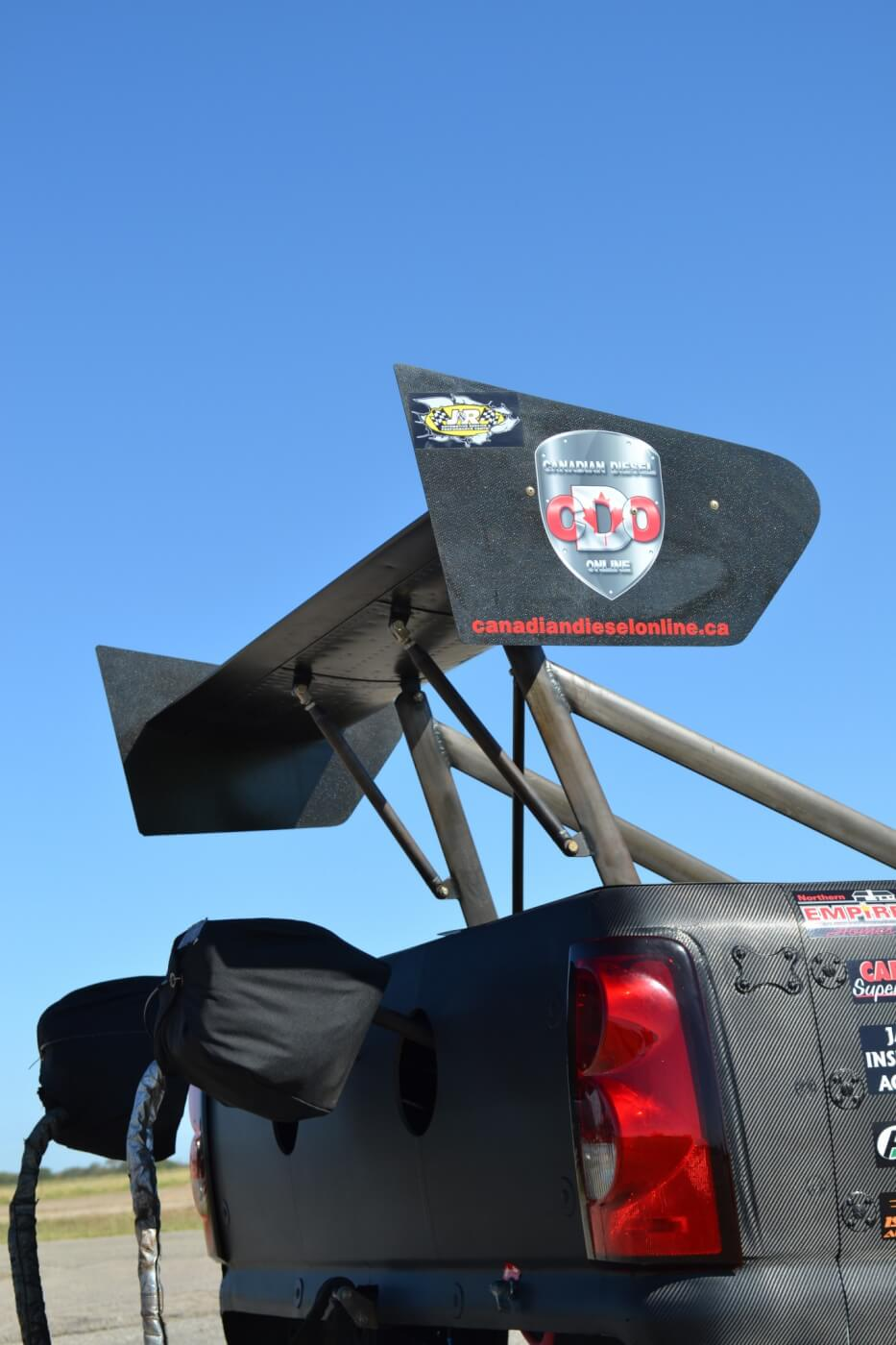 The team is aiming high when it comes to performance. The rear wing is a Top Fuel-style unit that provides an awesome amount of down force at the top end of the track to keep the truck straight, while the dual parachutes are an NHRA requirement in case the truck tops 200 mph in the quarter-mile, which is a very real possibility.