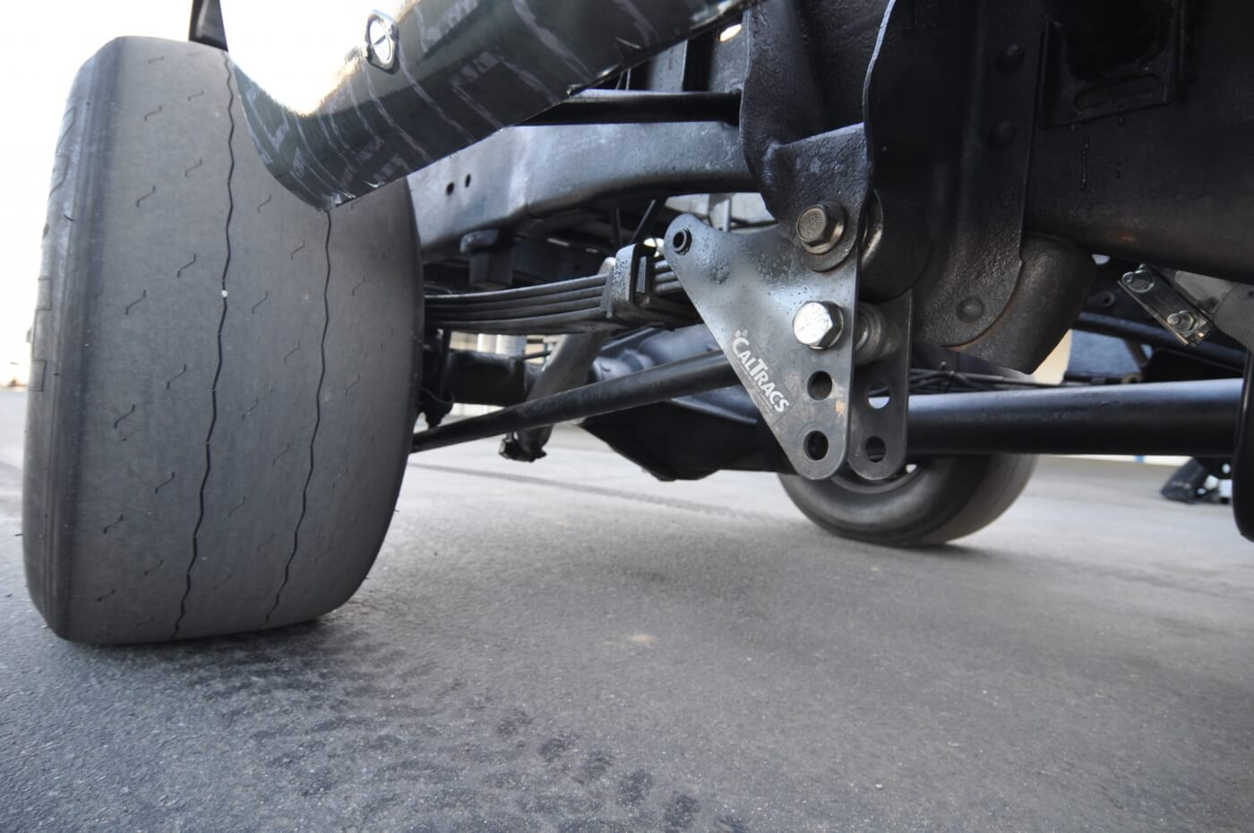 CalTracs traction bars are essential to reducing axle wrap and increasing traction. Of course, the race slicks are a big part of the traction equation too.