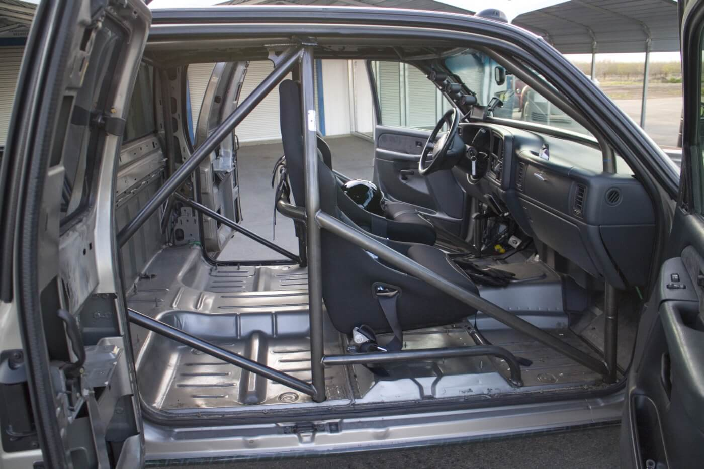 To lighten the truck, the interior was stripped out. A cage from Rollover Motorsports was installed for safety. The stock seats were replaced with a pair of Corbeau seats with 5-point belts.