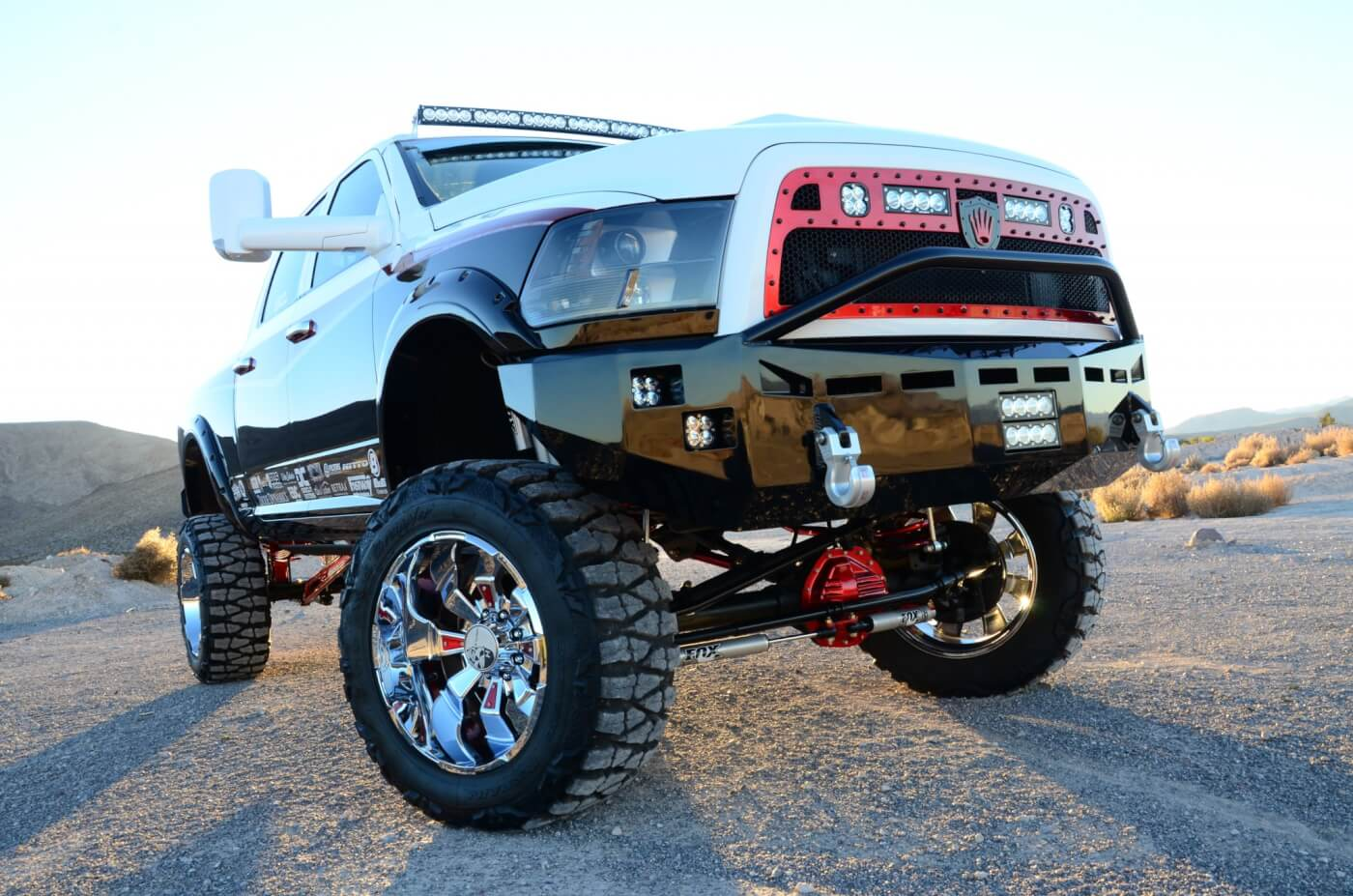 A pair of color matched Fusion Bumpers packed with Baja Designs LED lights protect the front and rear ends.